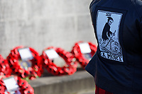 Pictured: A woman wearing a jacket with a skeleton figure stands by the Wreaths laid at the Cenotaph in Swansea, Wales, UK. Sunday 10 November 2019<br /> Re: Remembrance SUnday, a service to commemorate those who lost their lives in conflict has been held at the Cenotaph in Swansea, Wales, UK.
