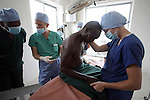 TANGA, TANZANIA - JULY 7: A doctor helps and comforts a patient before going into surgery in the Pongwe Clinic in Tanga, Tanzania. Because of the sparse facilities, with medical supplies and training for staff donated by a Non-government Organization, many of the surgeries in this and other clinics are done with only local anesthesia. The Tanzanian health care system has seen a gradual decline with low medical staff morale due to declining wages and operational difficulties in the central medical stores and domestic pharmaceuticals industries.