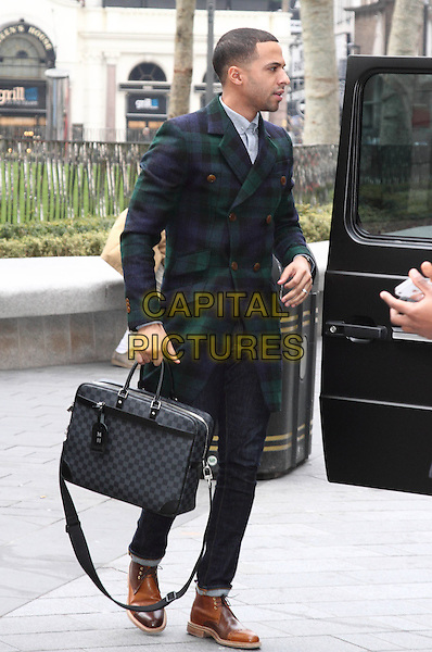 Marvin Humes arrives for his 1st Day at work at Capital FM, Leicester Square, London, England..28th March 2013.jls full length green blue check plaid tartan jacket coat jeans denim briefcase jeans denim brown shoes side profile .CAP/ROS.©Steve Ross/Capital Pictures..