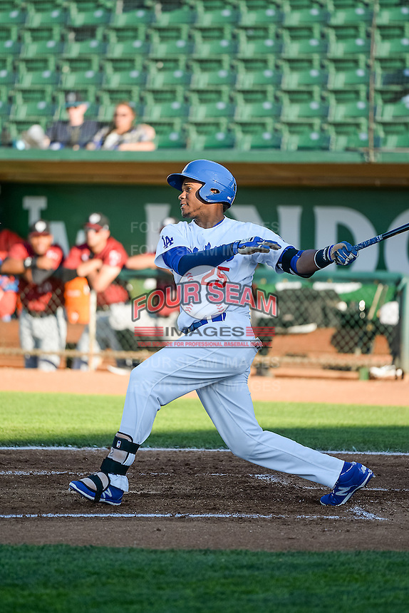 Michael Medina (25) of the Ogden Raptors at bat against the Idaho Falls Chukars in Pioneer League action at Lindquist Field on June 23, 2015 in Ogden, Utah. Idaho Falls beat the Raptors 9-6.(Stephen Smith/Four Seam Images)