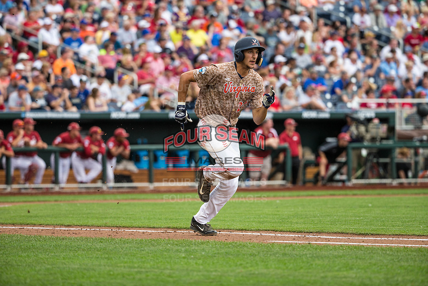 Daniel Pinero (22) of the Virginia Cavaliers bats during a game between the Virginia Cavaliers and Arkansas Razorbacks at TD Ameritrade Park on June 13, 2015 in Omaha, Nebraska. (Brace Hemmelgarn/Four Seam Images)