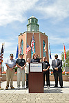 East Meadow, New York, U.S. - September 3, 2014 - KATHLEEN RICE, at podium, Democratic congressional candidate (NY-04), releases a whitepaper on veterans policy and announces formation of her campaign's Veterans Advisory Committee, at Veterans Memorial at Eisenhower Park, after touring Northport VA Medical Center with outgoing Rep. CAROLYN MCCARTHY (in white jacket). Congresswoman McCarthy and 4 committee members joined Rice at the press conference: PAUL ZYDOR, (in blue shirt) of Merrick, U.S. Navy, Korean War Veteran; PAT YNGSTROM, (in black T-shirt and cap) of Merrick, U.S. Army Paratrooper, Vietnam War Veteran; STEVE BONOM, (in black T-shirt and pants) of Massapequa, U.S. Navy, Vietnam War Veteran; and JEREMIAH E. BRYANT, wearing American Flag tie and black suit, of Rockville Centre, U.S. Army, Vietnam War Veteran. Rice is in her third term as Nassau County District Attorney, Long Island.