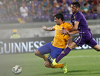Calcio: amichevole Fiorentina vs Barcellona. Firenze, stadio Artemio Franchi, 2 agosto 2015.<br /> FC Barcelona's Luis Suarez, left, kicks to score as Fiorentina's Gonzalo Rodriguez tries to stop him during the friendly match between Fiorentina and FC Barcelona at Florence's Artemio Franchi stadium, 2 August 2015.<br /> UPDATE IMAGES PRESS/Riccardo De Luca