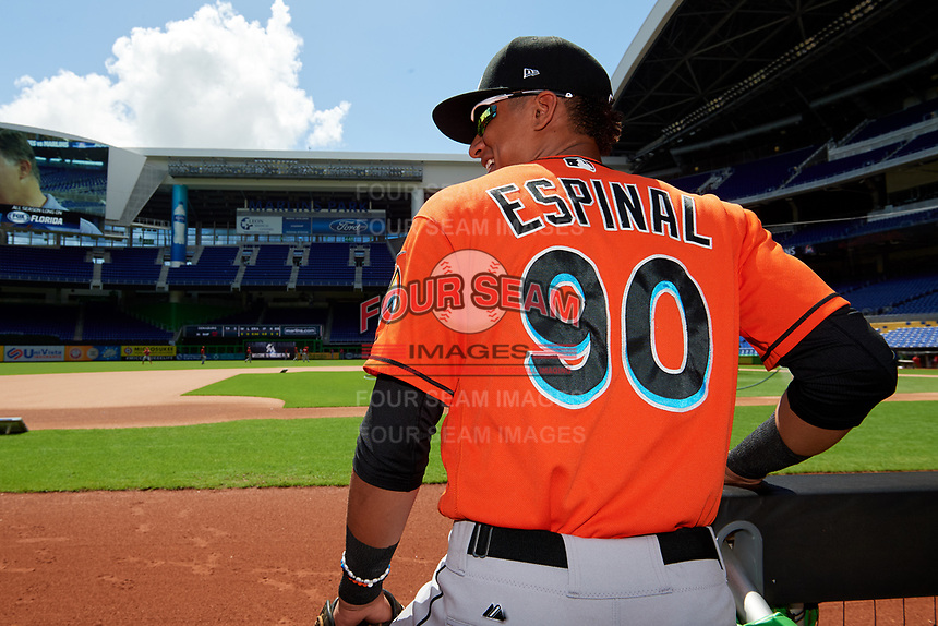 Miami Marlins Walner Espinal (90) in the dugout before a Florida Instructional League game against the Washington Nationals on September 26, 2018 at the Marlins Park in Miami, Florida.  (Mike Janes/Four Seam Images)