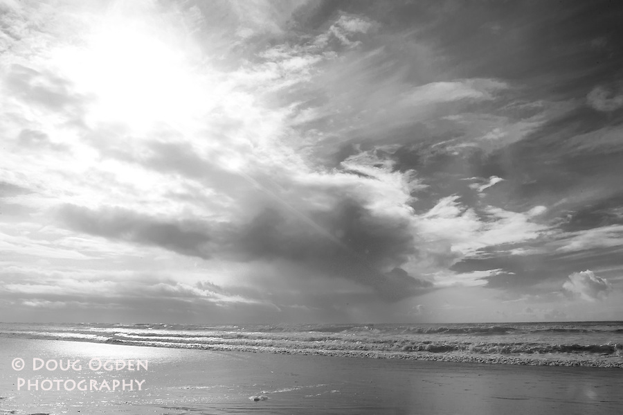Dramatic clouds and rainstorm out to sea - Black and White
