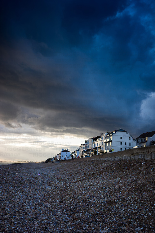 Stormy skies over the seafront in Hythe, Kent, England