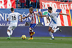 Atletico de Madrid´s Alessio Cerci (C) and Deportivo de la Coruña´s Insua during 2014-15 La Liga match between Atletico de Madrid and Deportivo de la Coruña at Vicente Calderon stadium in Madrid, Spain. November 30, 2014. (ALTERPHOTOS/Victor Blanco)
