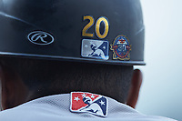 A closeup of the 30th Anniversary sticker on the helmet of Scranton/Wilkes-Barre RailRiders first base coach Julio Borbon (20) during the game against the Gwinnett Stripers at Coolray Field on August 18, 2019 in Lawrenceville, Georgia. The RailRiders defeated the Stripers 9-3. (Brian Westerholt/Four Seam Images)