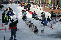 Dee Dee Jonrowe leaves the Anchorage start line on 4th avenue during the start of the Iditarod.