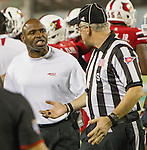 Louisville Cardinals head coach Charlie Strong argues the safety on the first possession as the Louisville Cardinals played the Miami Hurricanes in the Russell Athletic Bowl in Orlando, Fl. on December 28, 2013.  Photo by Mark Mahan