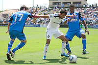 Juninho (center) separates Joey Gjersen (left) and Khari Stephenson. The San Jose Earthquakes defeated the LA Galaxy 1-0 at Buck Shaw Stadium in Santa Clara, California on August 21st, 2010.