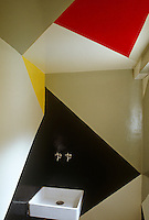 A geometric mural in red, grey, yellow and black was designed by Theo van Doesburg to dramatic effect in the flower room
