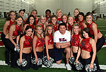 Ole Miss head coach Ed Orgeron smiles with the Rebelettes during Wednesday night's spring practice session that was open to students, who were treated to a pep talk by Coach Orgeron, as well as autographs and photos. Photo by Nathan Latil/Ole Miss Communications