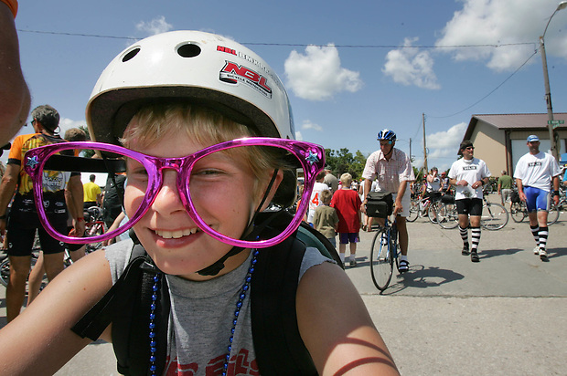 Tommy Dexter, 13, of Cedar Falls sports some big glasses for his ride through Lacona Wednesday on RAGBRAI XXXVII.  Tommy is riding portions of the route while his father drives a team bus.