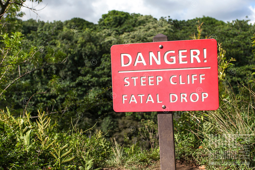 """Danger! Steep Cliff, Fatal Drop"" sign on the  Pipiwai hiking trail, Haleakala National Park, Kipahulu, Maui"