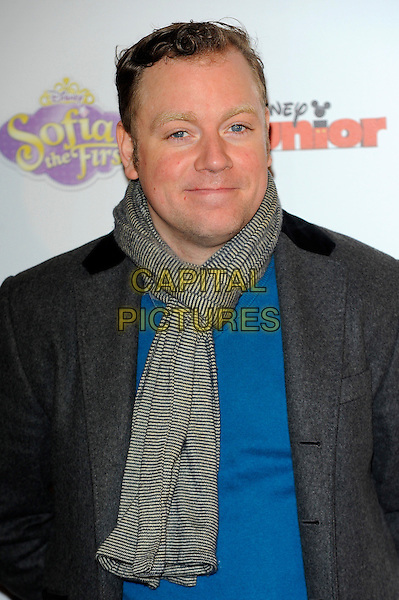 Rufus Hound.The launch of the Disney TV Series 'Sofia The First' at the Mayfair Hotel, London, England..22nd February 2013.headshot portrait grey gray scarf coat blue top .CAP/CJ.©Chris Joseph/Capital Pictures.