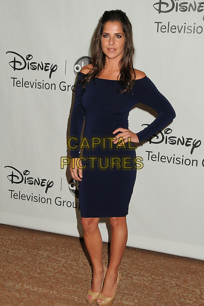Kelly Monaco.Disney ABC Television Group 2012 TCA Summer Press Tour Party held at the Beverly Hilton Hotel, Beverly Hills, California, USA, 27th July 2012..full length off the shoulder dress hand on hip long sleeve  blue navy  .CAP/ADM/BP.©Byron Purvis/AdMedia/Capital Pictures.