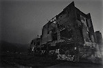 An gutted office building barely stands amid the wasteland created by the March 11 quake and tsunami in Otsuchi, Iwate Prefecture, Japan.  Photographer: Robert Gilhooly