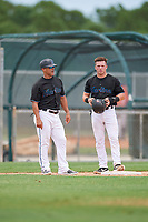GCL Marlins manager Robert Rodriguez (3) and Keegan Fish (7) during a Gulf Coast League game against the GCL Astros on August 8, 2019 at the Roger Dean Chevrolet Stadium Complex in Jupiter, Florida.  GCL Marlins defeated GCL Astros 5-4.  (Mike Janes/Four Seam Images)