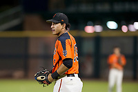 Ricardo Genoves (15) of the AZL Giants warms up left fielder Nick Hill (22) during Game Three of the Arizona League Championship Series against the AZL Cubs on September 7, 2017 at Scottsdale Stadium in Scottsdale, Arizona. AZL Cubs defeated the AZL Giants 13-3 to win the series two games to one. (Zachary Lucy/Four Seam Images)