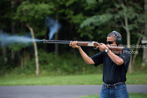 United States President Barack Obama shoots clay target on the range at Camp David, Maryland, Saturday, August 4, 2012. .Mandatory Credit: Pete Souza - White House via CNP