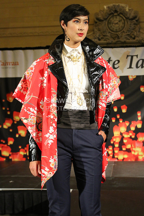 Model walks runway in an outfit from the Malan Breton Spring 2015 collection, during the Celebrate Taiwan event in Grand Central Terminal on September 27, 2014.