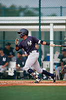 GCL Yankees East first baseman Starlin Paulino (6) follows through on a swing during the first game of a doubleheader against the GCL Pirates on July 31, 2018 at Pirate City Complex in Bradenton, Florida.  GCL Yankees East defeated GCL Pirates 2-0.  (Mike Janes/Four Seam Images)