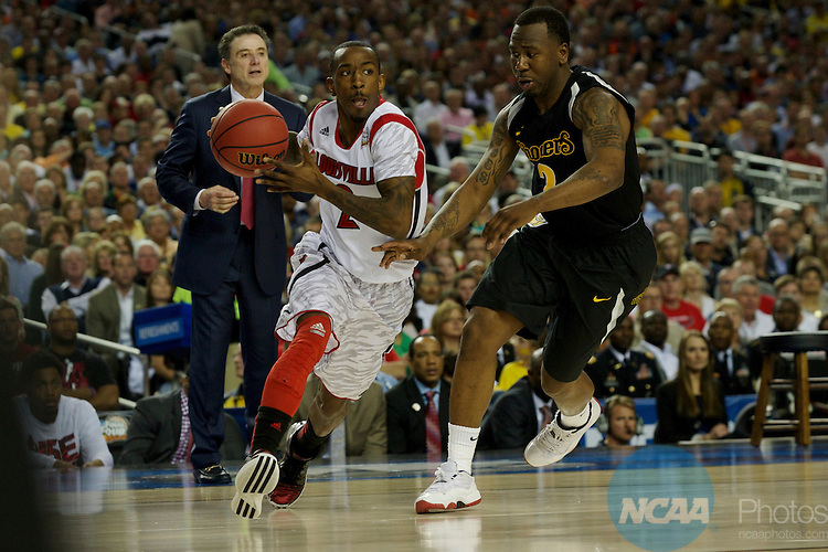 06 APR 2013: Russ Smith (2) of the University of Louisville drives towards the basket against Malcolm Armstead (2) of Wichita State University drives down court next to  during semifinal game of the 2013 NCAA Men's DI Basketball Championship Final Four held at the Georgia Dome in Atlanta, GA. Louisville defeated Wichita 72-68 to advance to the final game. Rich Clarkson/NCAA Photos