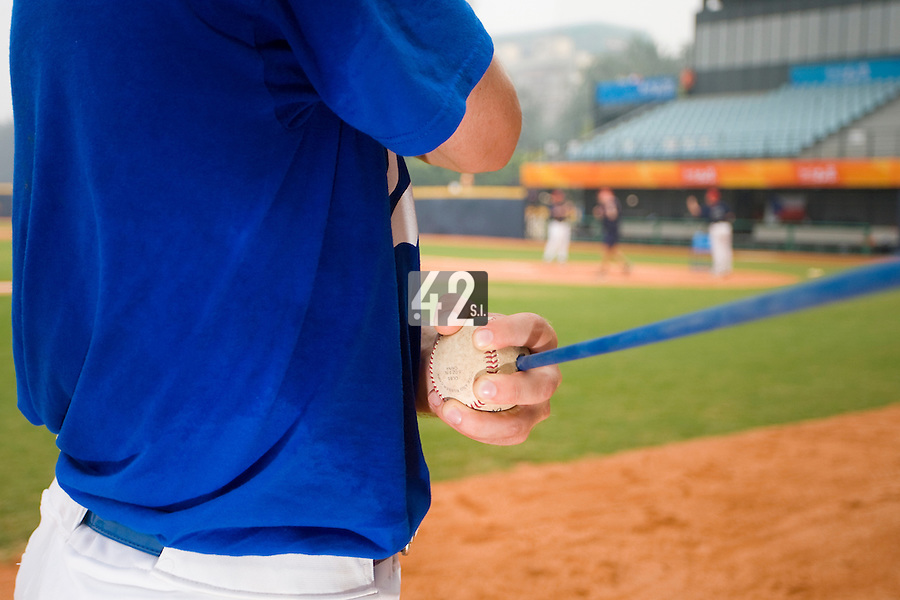 20 August 2007: Close up view of Patrick Carlson warming up prior to the Czech Republic 6-1 victory over France in the Good Luck Beijing International baseball tournament (olympic test event) at the Wukesong Baseball Field in Beijing, China.