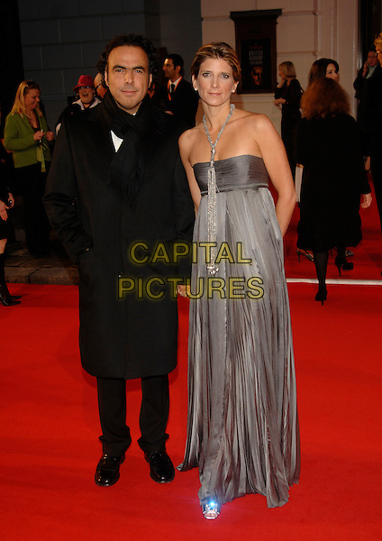 ALEJANDRO GONZALEZ INARRITU & GUEST.Red Carpet Arrivals at The Orange British Academy Film Awards (BAFTA's) held at the Royal Opera House, Covent Garden, London, England, February 11th 2007..full length black strapless grey silver dress.CAP/PL.©Phil Loftus/Capital Pictures