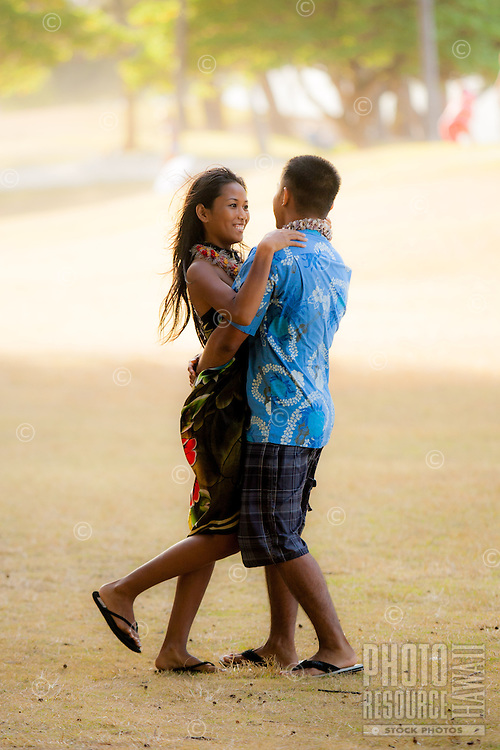 A young local couple bask in their engagement on Kailua Beach, Windward O'ahu.