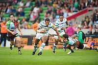 130712 Copyright onEdition 2012 ©.Free for editorial use image, please credit: onEdition..Chris Hala'ufia of London Irish evades the tackle of Ollie Lindsay-Hague of Harlequins  at The Stoop, Twickenham in the first round of The J.P. Morgan Asset Management Premiership Rugby 7s Series...The J.P. Morgan Asset Management Premiership Rugby 7s Series kicked off again for the third season on Friday 13th July at The Stoop, Twickenham with Pool B being played at Edgeley Park, Stockport on Friday, 20th July, Pool C at Kingsholm Gloucester on Thursday, 26th July and the Final being played at The Recreation Ground, Bath on Friday 3rd August. The innovative tournament, which involves all 12 Premiership Rugby clubs, offers a fantastic platform for some of the country's finest young athletes to be exposed to the excitement, pressures and skills required to compete at an elite level...The 12 Premiership Rugby clubs are divided into three groups for the tournament, with the winner and runner up of each regional event going through to the Final. There are six games each evening, with each match consisting of two 7 minute halves with a 2 minute break at half time...For additional images please go to: http://www.w-w-i.com/jp_morgan_premiership_sevens/..For press contacts contact: Beth Begg at brandRapport on D: +44 (0)20 7932 5813 M: +44 (0)7900 88231 E: BBegg@brand-rapport.com..If you require a higher resolution image or you have any other onEdition photographic enquiries, please contact onEdition on 0845 900 2 900 or email info@onEdition.com.This image is copyright the onEdition 2012©..This image has been supplied by onEdition and must be credited onEdition. The author is asserting his full Moral rights in relation to the publication of this image. Rights for onward transmission of any image or file is not granted or implied. Changing or deleting Copyright information is illegal as specified in the Copyright, Design and Patents Act 1988. If you are in any way unsure of your right t