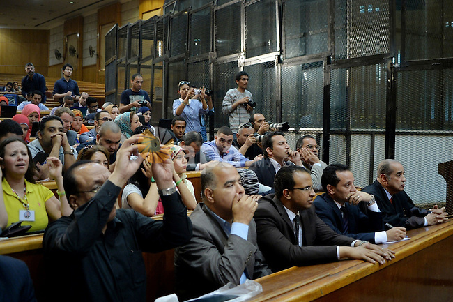 Supporters of Egypt's former president Hosni Mubarak, cry after his verdict hearing in a retrial for embezzlement on May 9, 2015 in the capital Cairo. The Egyptian court sentenced Mubarak and his two sons to three years in prison. Photo by Stranger