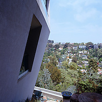 The house protrudes from the hillside and has a panoramic view of the houses on the hillside opposite