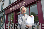WARNING: Mike Venner of the Dingle Bookshop warning businesses about the European City Guide scam in Dingle on Friday.