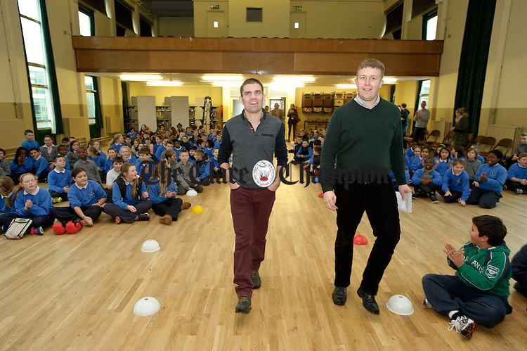 Former WBA Super bantamweight champion Bernard Dunne, a Carambola Kids ambassador,  arrives with school PE coordinator Sean O Neill to The Holy family school in Ennis to promote the importance of healthy eating and physical fitness. Photograph by John Kelly.