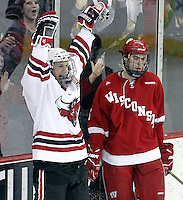 UNO's Matt Ambroz celebrates his second goal of the game. Ambroz's goal put UNO up 4-1 during the third period. Looking on is Wisconsin's Justin Schultz. No. 16 UNO beat No. 7 Wisconsin 4-3 Saturday night at Qwest Center Omaha. (Photo by Michelle Bishop)