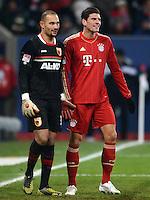 FUSSBALL   1. BUNDESLIGA  SAISON 2012/2013   16. Spieltag FC Augsburg - FC Bayern Muenchen         08.12.2012 Torwart Mohamed Amsif (li, FC Augsburg) mit Mario Gomez (FC Bayern Muenchen)