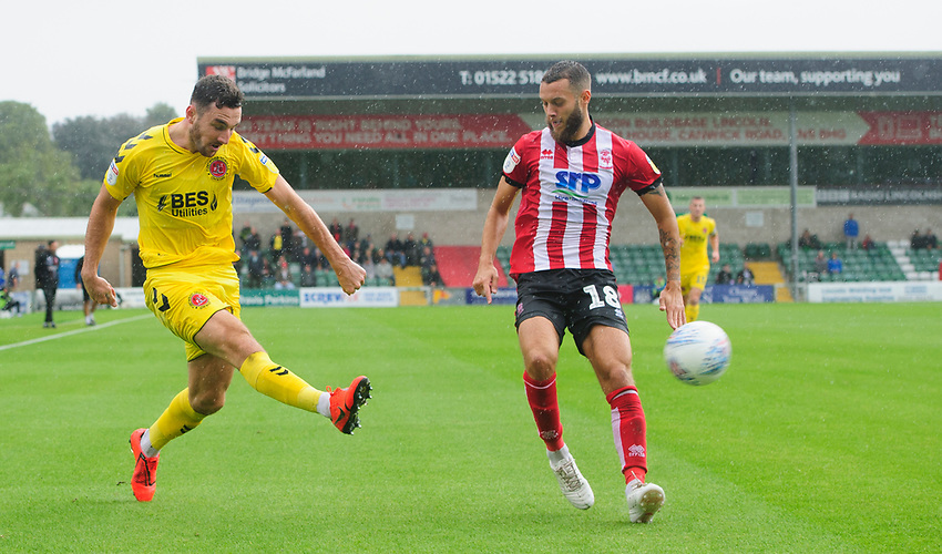 Fleetwood Town's Lewis Coyle under pressure from Lincoln City's Jorge Grant<br /> <br /> Photographer Chris Vaughan/CameraSport<br /> <br /> The EFL Sky Bet League One - Lincoln City v Fleetwood Town - Saturday 31st August 2019 - Sincil Bank - Lincoln<br /> <br /> World Copyright © 2019 CameraSport. All rights reserved. 43 Linden Ave. Countesthorpe. Leicester. England. LE8 5PG - Tel: +44 (0) 116 277 4147 - admin@camerasport.com - www.camerasport.com