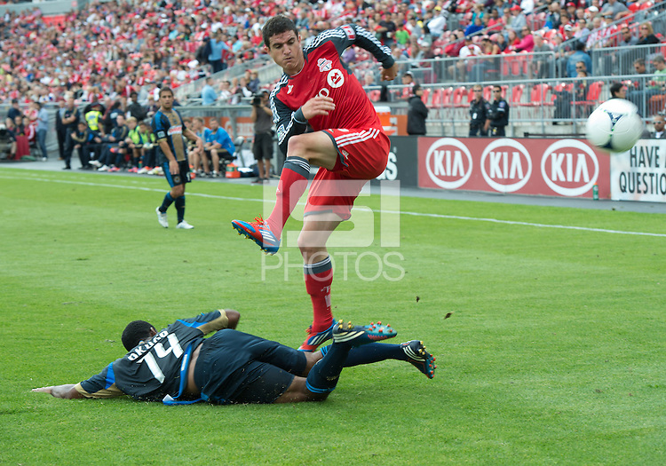 15 September 2012: Philadelphia Union midfielder Amobi Okugo #14 and Toronto FC defender Logan Emory #2 in action during an MLS game between the Philadelphia Union and Toronto FC at BMO Field in Toronto, Ontario Canada. .