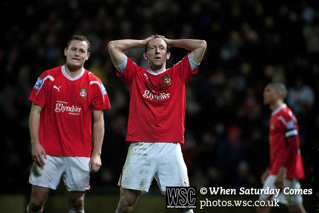 Wrexham 1 Brighton & Hove Albion 1, 18/01/2012. Racecourse Ground, FA Cup 3rd Round Replay. Wrexham player-manager Andy Morrell reacts with disbelief at a missed chance during extra time against Brighton and Hove Albion in an FA Cup third round replay, at the Racecourse Ground played following the teams one-all draw in the first match. The replay was won by Brighton, 5-4 on penalty kicks after the match had ended in a one-all draw after extra time, watch by a crowd of 8316. The visitors played in the Championship, three leagues above their rivals from Wales, who were top of the Conference at the time of the match. Photo by Colin McPherson.