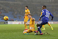 Junior Hoilett of Cardiff City has a shot on goal whilst under pressure from Tom Clarke(captain) of Preston North End during the Sky Bet Championship match between Cardiff City and Preston North End at Cardiff City Stadium, Wales, UK. Tuesday 31 January 2017