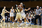 DURHAM, NC - FEBRUARY 01: Duke's Lexie Brown (4) is tied up by Georgia Tech's Taja Cummings (3) and Breanna Brown (behind). The Duke University Blue Devils hosted the Georgia Tech University Yellow Jackets on February 1, 2018 at Cameron Indoor Stadium in Durham, NC in a Division I women's college basketball game. Duke won the game 77-59.