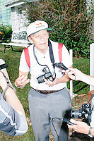 Reporters interview an attendee after Vermont senator and Democratic presidential candidate Bernie Sanders spoke at a campaign event at the White Mountain Chalet event hall in Berlin, New Hampshire.