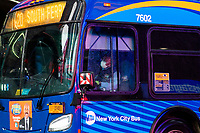 NEW YORK, NY - April 13:  A MTA bus drives down 7 avenue at Times Square during a rainy day on April 13, 2020. in New York, United States. The global economy is facing the worst collapse since the WWII, while COVID-19  pandemic has now killed more than 22,000 people in the United States and at least 1,864,629 people died world wide.  (Photo by Eduardo MunozAlvarez/VIEWpress)