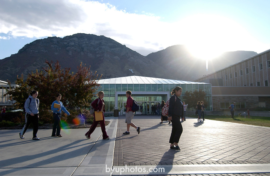 1003-13  GCS Sunrise..10/7/03..Photo by Jaren Wilkey/BYU..Sunrise Silhouettes in front of lower quad,..students walking to class
