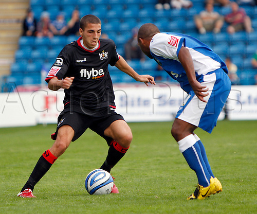5th September 2009. Exeter's Liam Sercombe (in black) attacks the Gillingham defence during the second half. Division 1 match - Gillingham v Exeter City at Priestfield Stadium, Gillingham, Kent, England.Photo: Colin Read/Actionplus.