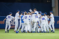 The Florida Gators celebrate their win over the Wake Forest Demon Deacons in Game One of the Gainesville Super Regional of the 2017 College World Series at Alfred McKethan Stadium at Perry Field on June 10, 2017 in Gainesville, Florida.  The Gators defeated the Demon Deacons 2-1 in 11 innings.  (Brian Westerholt/Four Seam Images)