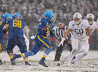 Philadelphia, PA - December 9, 2017:    Navy Midshipmen running back Keoni-Kordell Makekau (36) runs the ball during the 118th game between Army vs Navy at Lincoln Financial Field in Philadelphia, PA. (Photo by Elliott Brown/Media Images International)