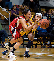 Brittany Boyd of California tries to knock the ball away from St. Mary's during the game at Haas Pavilion in Berkeley, California on November 15th, 2012.  California defeated St. Mary's, 89-41.